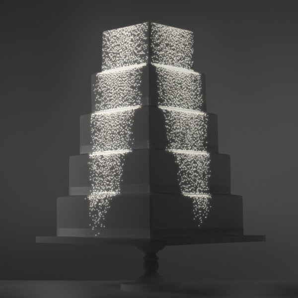 Particle Cascade video template projection mapped on a cake